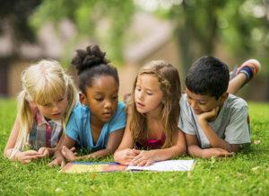 kids reading a book, diverse children reading, children reading outdoors